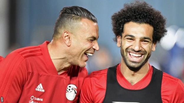Egypt goalkeeper Essam El-Hadary (left) jokes with forward Mohamed Salah
