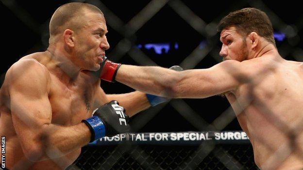 Georges St-Pierre beat Michael Bisping