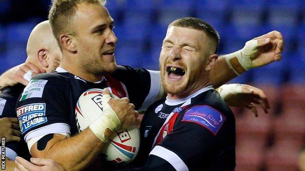 Salford's Lee Mossop celebrates his try against Wigan