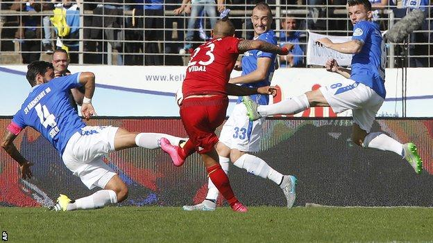 Arturo Vidal scores Bayern Munich's opening goal against SV Darmstadt