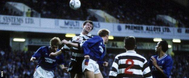 Brannigan battles for an aerial ball with Richard Gough and Maurice Johnston playing for East Stirling against Rangers