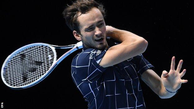 Daniil Medvedev returns against Diego Schwartzman at the ATP Finals in London