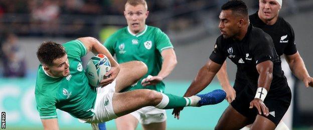 Ireland's Jacob Stockdale with Sevu Reece of New Zealand