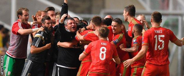 The Wales team and management celebrate in Cyprus
