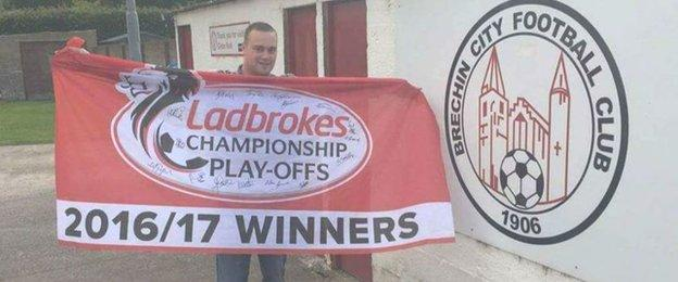 Dean Walker with his Brechin City play-off victory flag