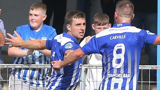 John Boyle celebrates scoring the goal which gave Newry victory over the Reds at the Showgrounds