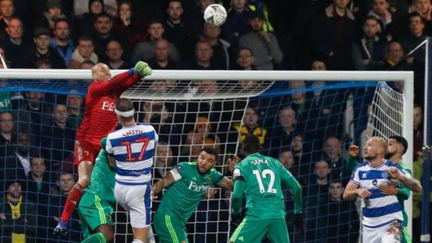 Watford goalkeeper Heurelho Gomes in action against Queens Park Rangers in the FA Cup