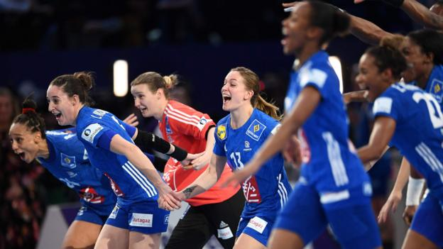 France's players celebrate after winning the EHF European Women's Championship against Russia at the AccorHotels Arena in Paris. (Photo by Anne-Christine/AFP/Getty Images)