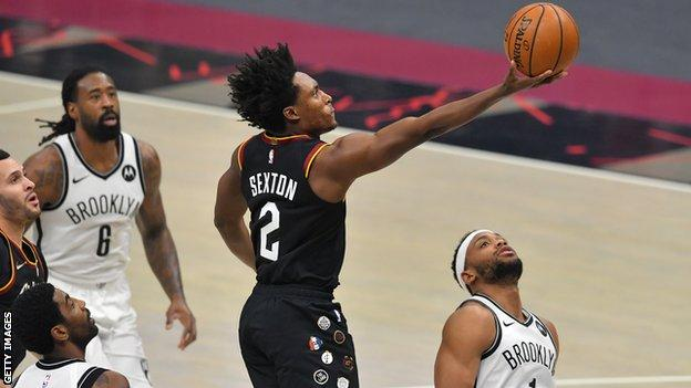 Collin Sexton shooting over Nets guard Bruce Brown