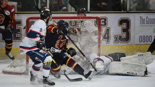 Guildford Flames' Jamie Crooks is denied by Dundee Stars goalie Pontus Sjogren during their game on Sunday