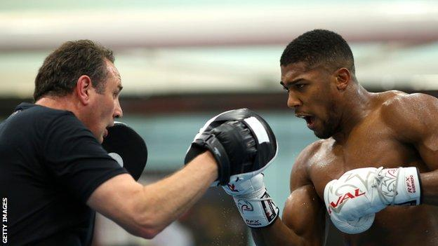 Rob McCracken and Anthony Joshua pictured during training