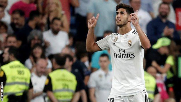 Real Madrid's Marco Asensio points to the sky after scoring against Espanyol