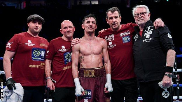 Anthony Crolla poses with his team in the ring after his final win