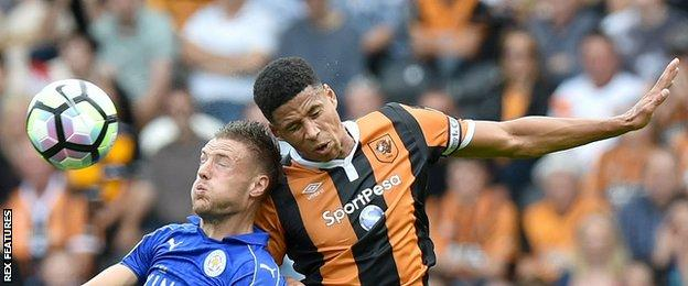 Hull defender Curtis Davies wins a header against Jamie Vardy