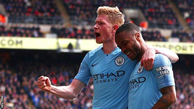 Kevin de Bruyne celebrates City's second goal with goalscorer Raheem Sterling