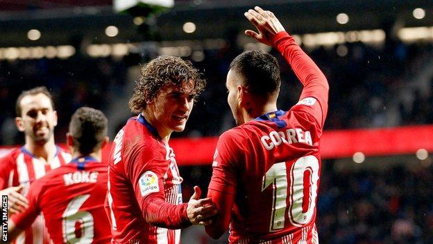 Antoine Griezmann and Angel Correa celebrate