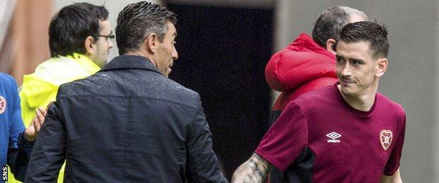 Rangers manager Pedro Caixinha greets target Jamie Walker at full-time
