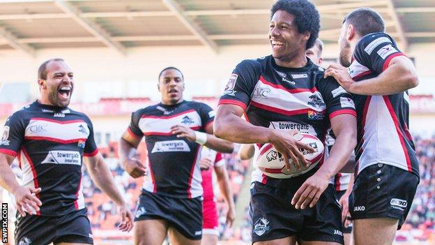 Oscar Thomas (second right) celebrates a try for London Broncos