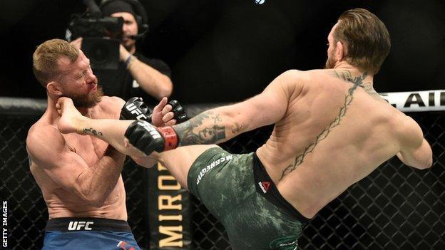 Conor McGregor kicks Donald Cerrone