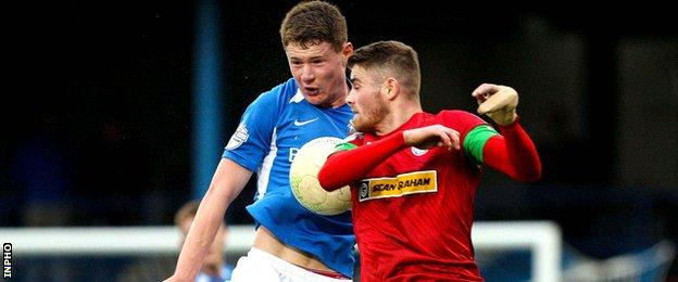 Glenavon's Patrick Burns and Rory Donnelly of Cliftonville