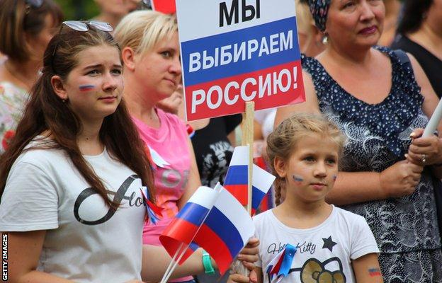 People in Donetsk attend an event marking Russia's National Flag Day in August 2019