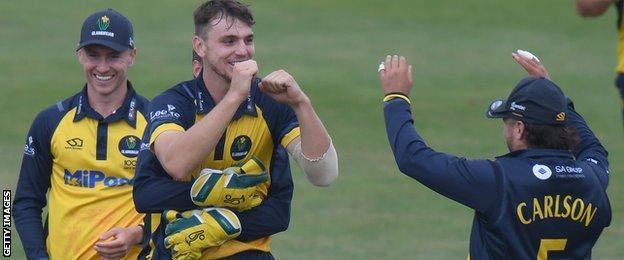 Joe Cooke (centre) celebrates a wicket for Glamorgan