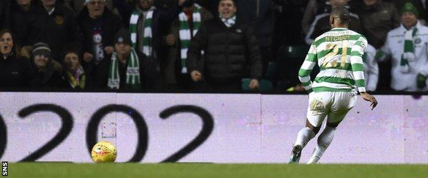 Olivier Ntcham rolls home Celtic's third goal against Aberdeen