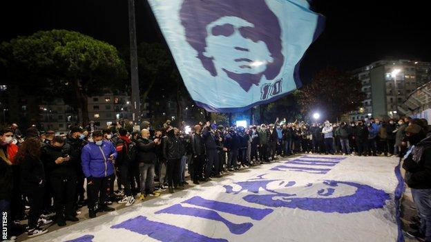 Fans gather outside Napoli's stadium to pay tribute to former player Maradona
