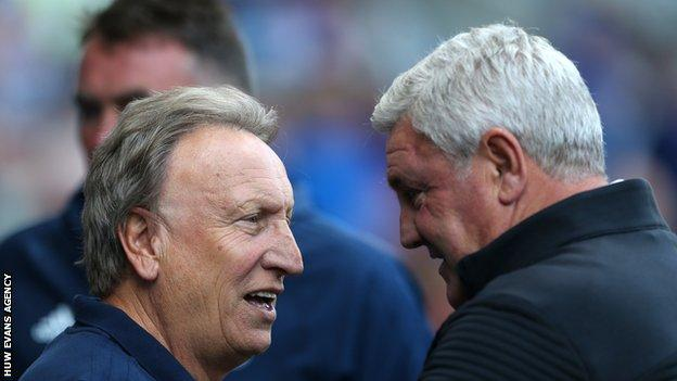 Rival managers Neil Warnock and Steve Bruce talk before kick-off in Cardiff