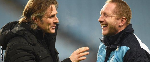 Gareth Ainsworth (left) shares a joke with assistant Richard Dobson