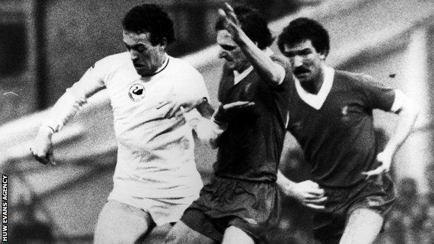 Swansea's Alan Curtis battles Liverpool's Phil Thompson as Graeme Souness looks on in a First Division clash in 1981-82