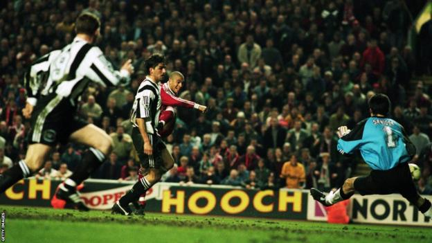 Stan Collymore scores the winner for Liverpool in their 4-3 victory over Newcastle in 1996