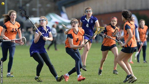 Young women playing lacrosse