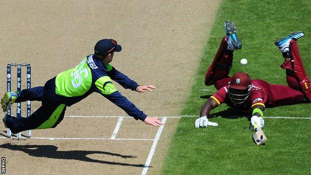 William Porterfield attempts to run out Darren Sammy as Ireland beat the West Indies at the 2015 World Cup