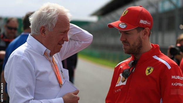 Charlie Whiting and Sebastian Vettel