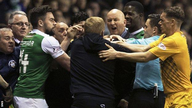 Hibernian manager Neil Lennon (centre) in amongst angry scenes