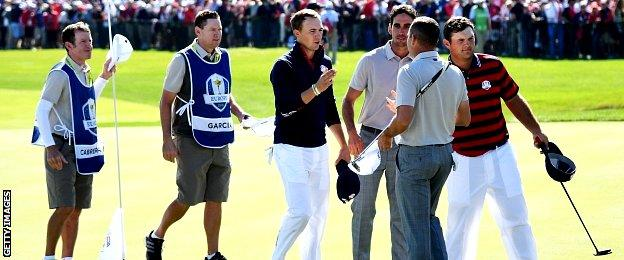 Jordan Spieth and Patrick Reed of the United States shake hands with Sergio Garcia and Rafa Cabrera Bello of Europe
