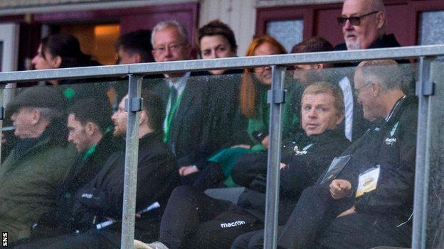 Neil Lennon watched the game from the stand as he served a touchline ban