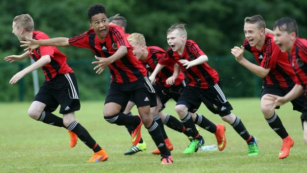 Hillsborough players celebrate after winning Under-13 Shield final in a penalty shoot-out against Carrick Rangers