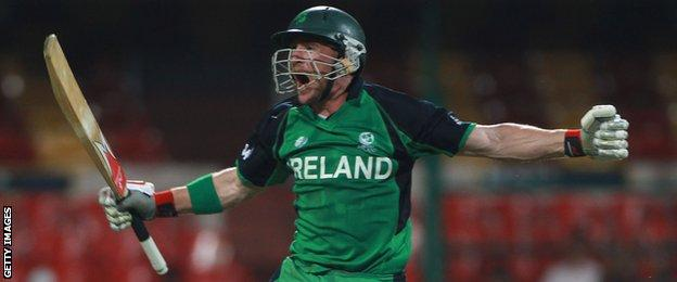 John Mooney celebrates after hitting the winning runs in Ireland's World Cup win over England in 2011