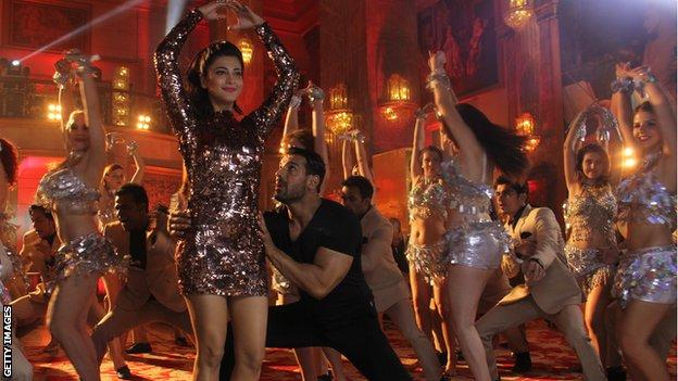 Bollywood actors John Abraham and Shruti Haasan during the on-location shoot of title song of Welcome Back at Imperial Palace, Goregaon