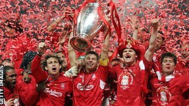 Liverpool players celebrate with the trophy after winning the 2004-05 Champions League final