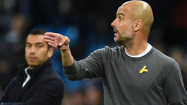 100270587 getty guardila yellow ribbon - Pep Guardiola: Manchester City boss suggested there is not a position for'political symbols in football'