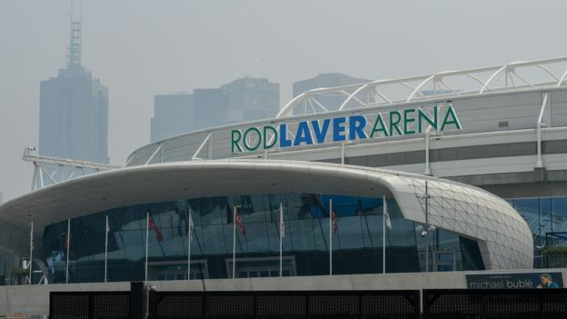 Australian Open 'is happening' despite air quality concerns, says tournament director thumbnail