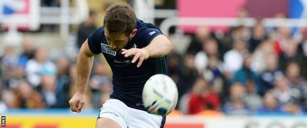 Greig Laidlaw kicks a penalty for Scotland against Samoa