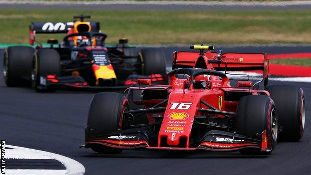 Ferrari's Charles Leclerc leads Red Bull's Max Verstappen during the British Grand Prix