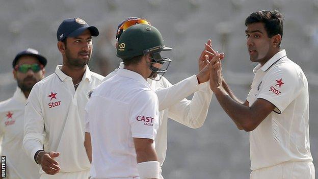 India's Ravichandran Ashwin (right) celebrates a wicket
