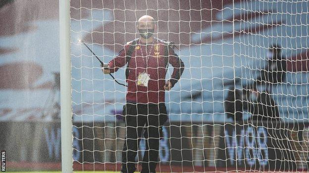 The goalposts at Aston Villa's Villa Park being cleaned