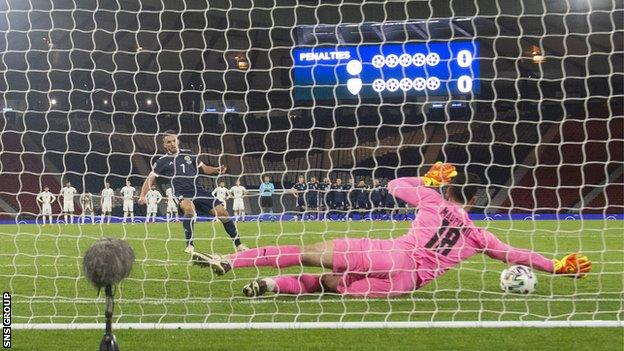 Israel goalkeeper Ofir Marciano just fails to keep out John McGinn's penalty in the Euro 2020 play-off semi-final