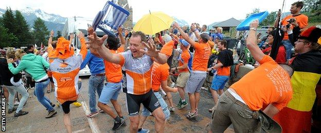 "Fans at '""Dutch Corner"" party and impede the traffic on the Alpe d'Huez stage of the 2013 Tour"